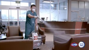 Man disinfecting with Clorox 360 spray